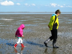 Mud walking with Oma during low tide