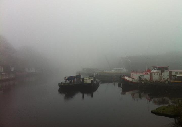 Amsterdam through the fog